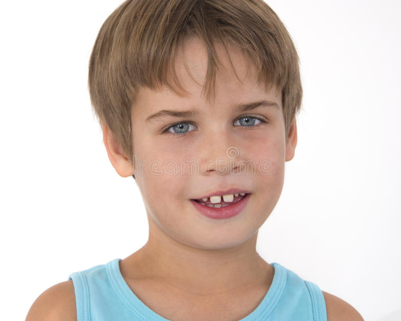 Sorriso novo do menino foto de stock