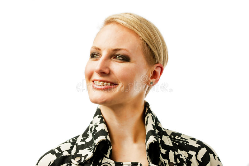 Sorrisos bonitos da mulher que mostram fora lhe cintas. fotos de stock