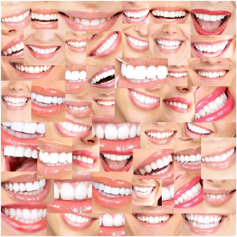 Sorrisos bonitos e dentes fotografia de stock