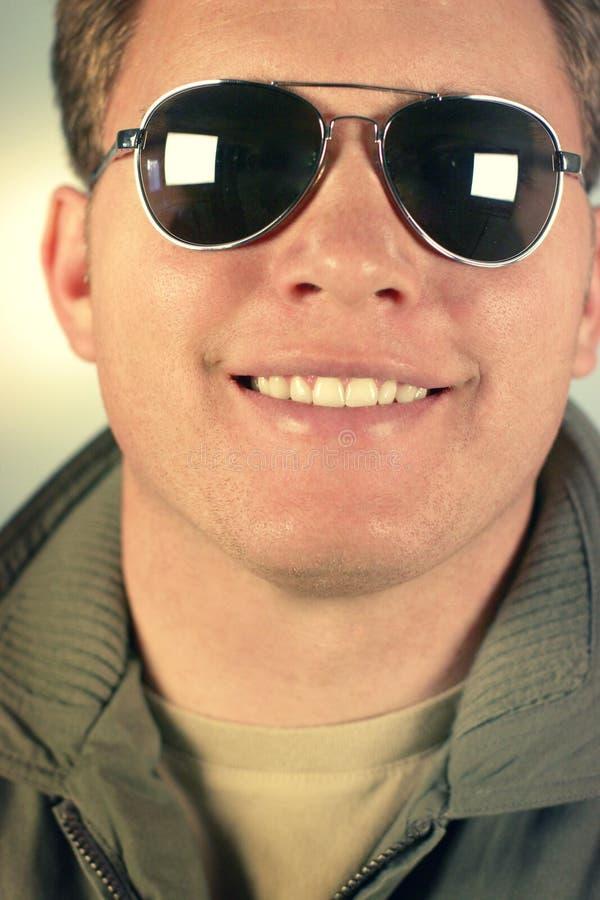 Sorrisos do homem imagens de stock