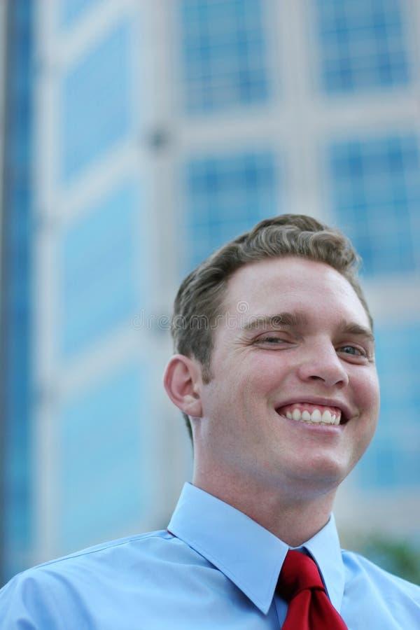 Sorrisos do homem de negócios fotos de stock royalty free