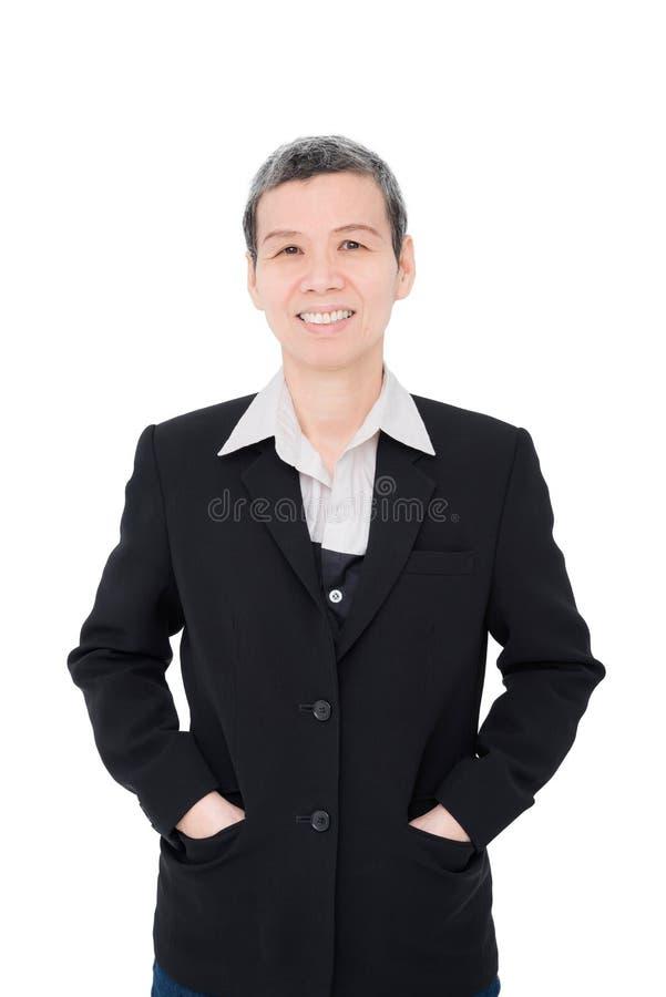 Sorrisos superiores da mulher de negócios foto de stock royalty free
