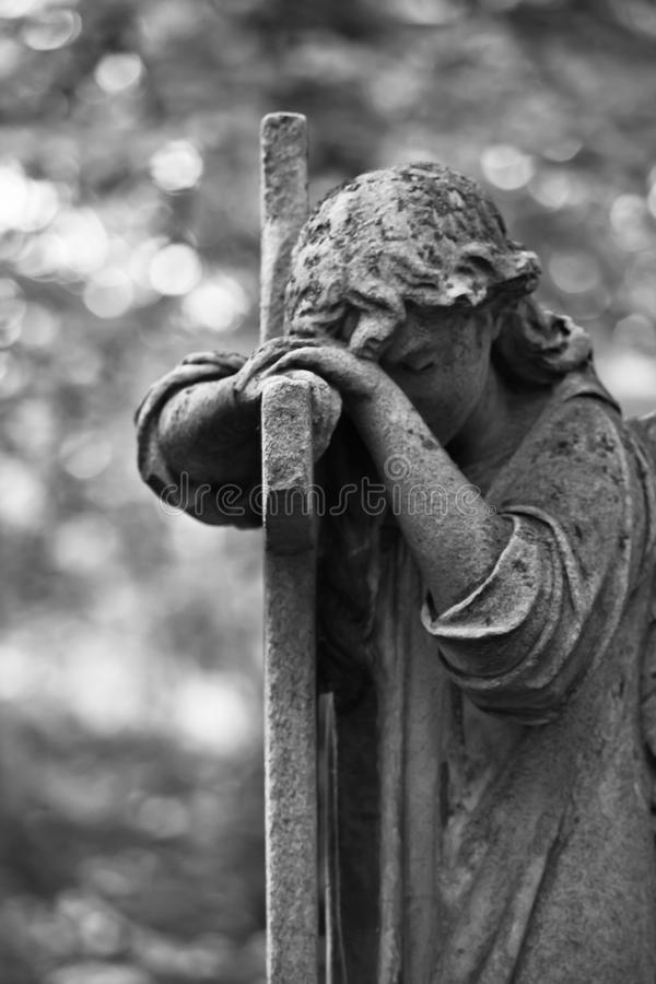 The Sorrowful Angel. Weeping Angel with a Cross. The Sorrowful Angel. The tomb of the 19th century, the German introduced city of Moscow royalty free stock images