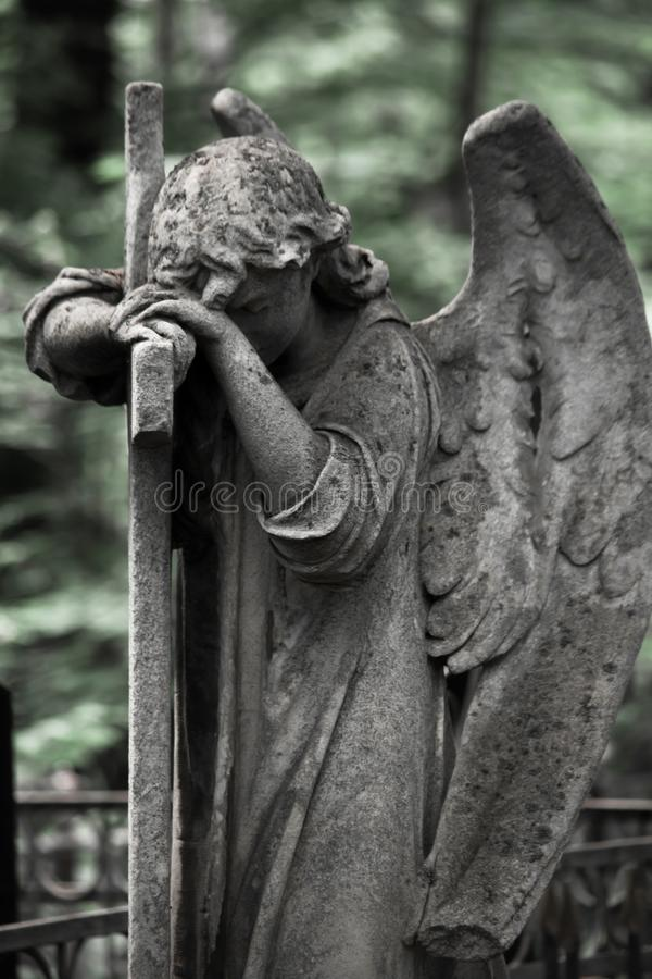 The Sorrowful Angel. Weeping Angel with a Cross. The Sorrowful Angel. The tomb of the 19th century, the German introduced city of Moscow stock image