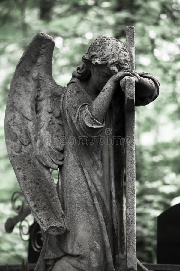 The Sorrowful Angel. Weeping Angel with a Cross. The Sorrowful Angel. The tomb of the 19th century, the German introduced city of Moscow royalty free stock photos
