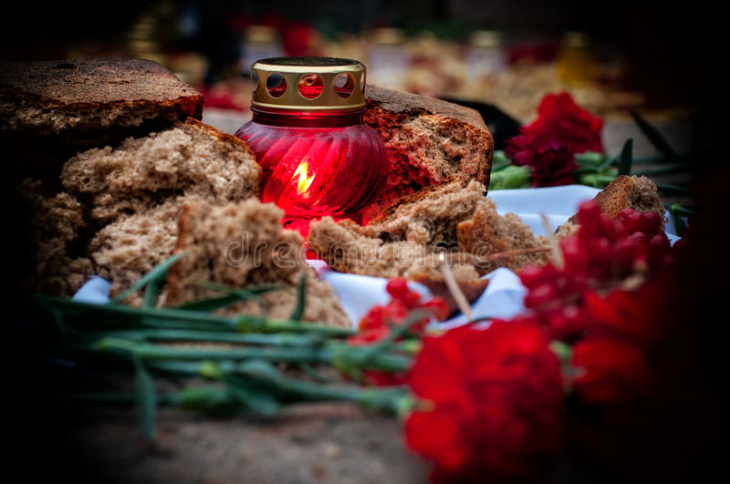 Sorrowful-candles and flowers in the memory of famine-genocide Starvation Holodomor royalty free stock photography