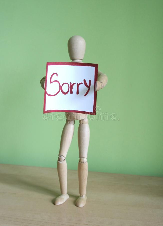 Sorry. Note on a puppet hand royalty free stock photo