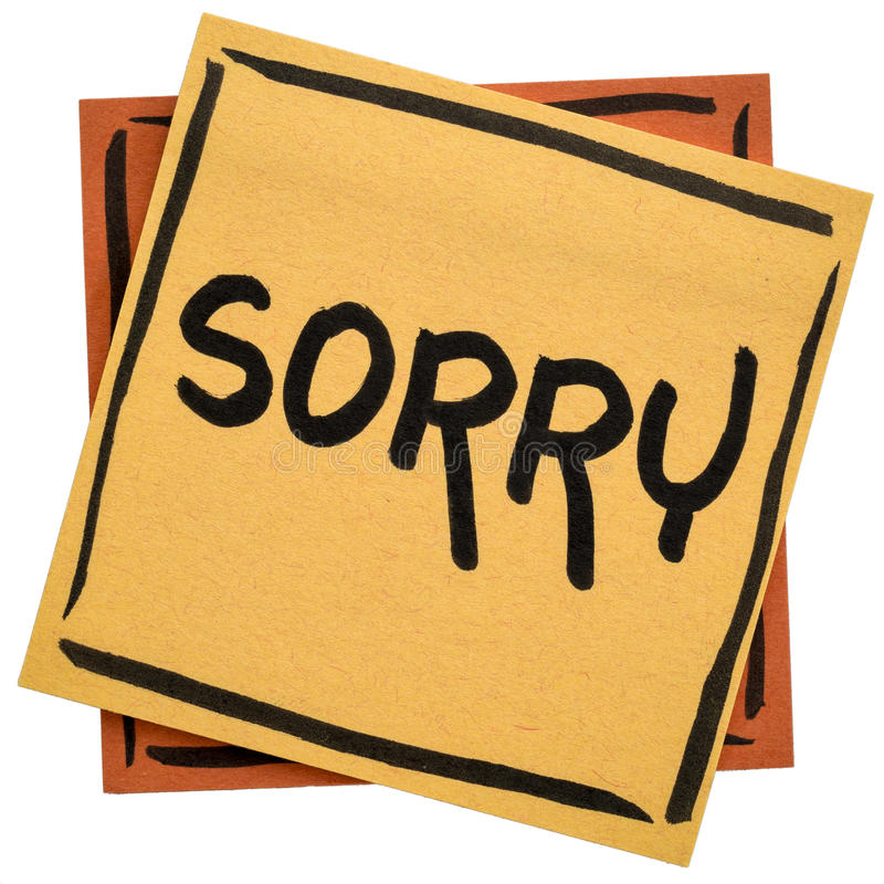 Sorry - apology on sticky note. Sorry apology - handwriting on an isolated sticky note royalty free stock photo