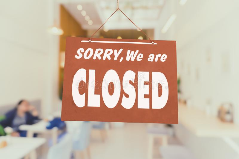 Sorry we are closed sign hang on door of business shop stock photography