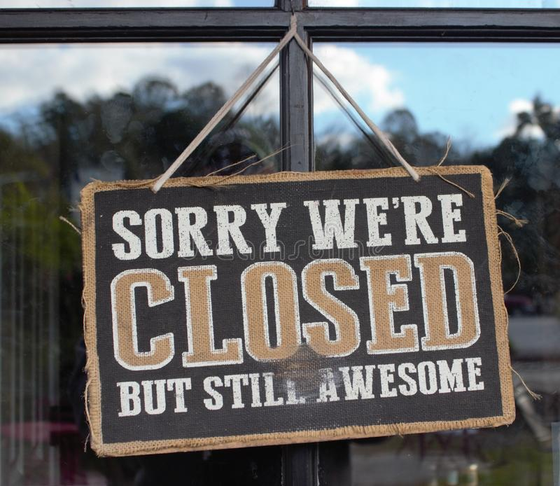 Sorry We Are Closed But Still Awesome Sign stock photo