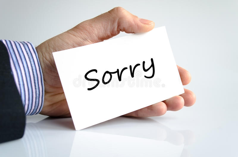 Sorry Concept. Sorry note in business man hand stock photos