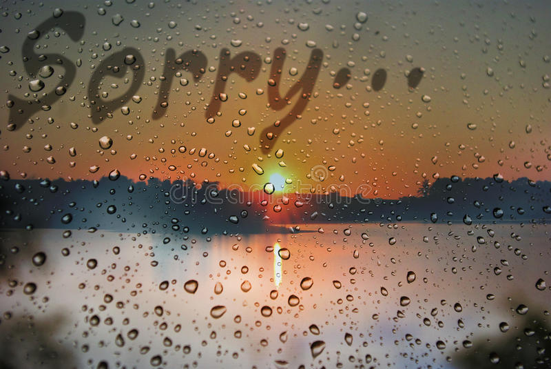 Sorry. The inscription on wet window `Sorry stock image