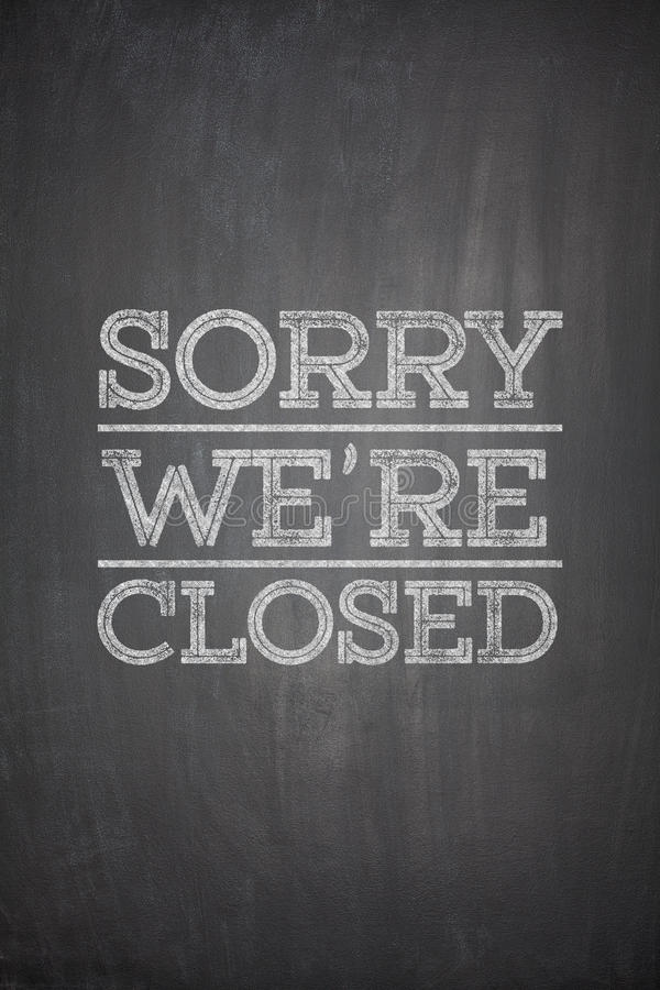 Sorry we're closed on blackboard stock photo