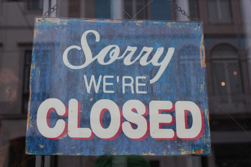 Sorry we're closed. Sign at the entrance of a shop stock images