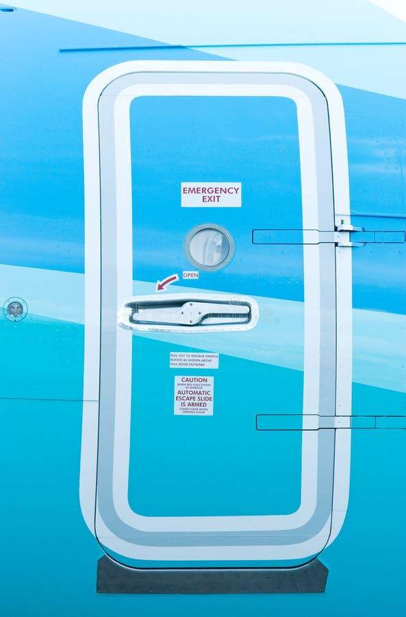 Sortie de secours sur l'avion image libre de droits