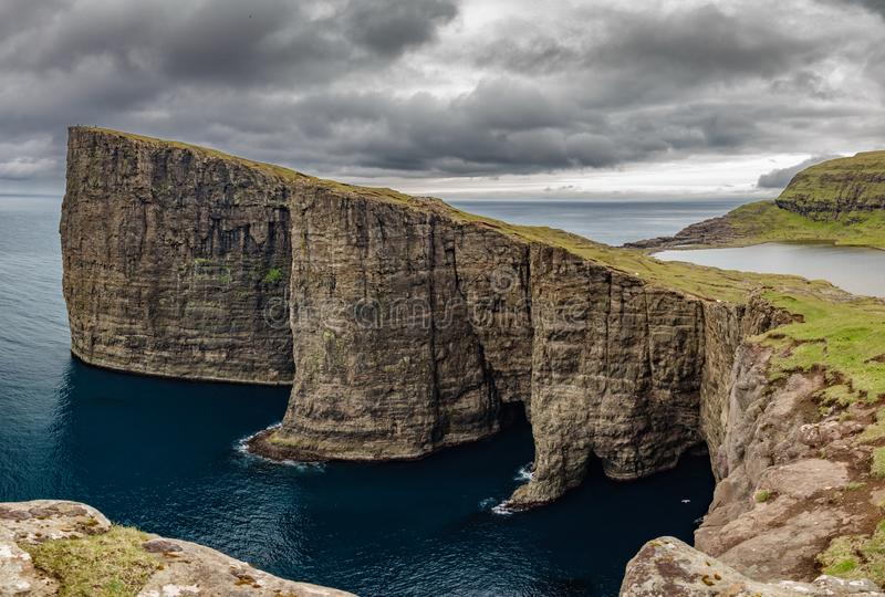 Sorvagsvatn lake over the ocean spectacular panorama, Faroe Islands. Huge spectacular panorama of Sorvagsvatn lake above the ocean in Vagar island, Faroe Islands royalty free stock image