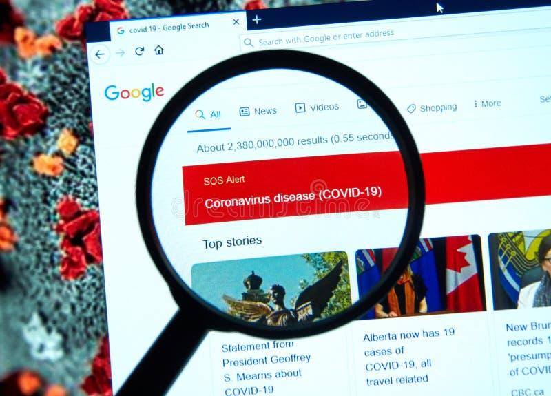 SOS Alert relativo a Coronavirus COVID-19 su google con lente di ingrandimento immagini stock
