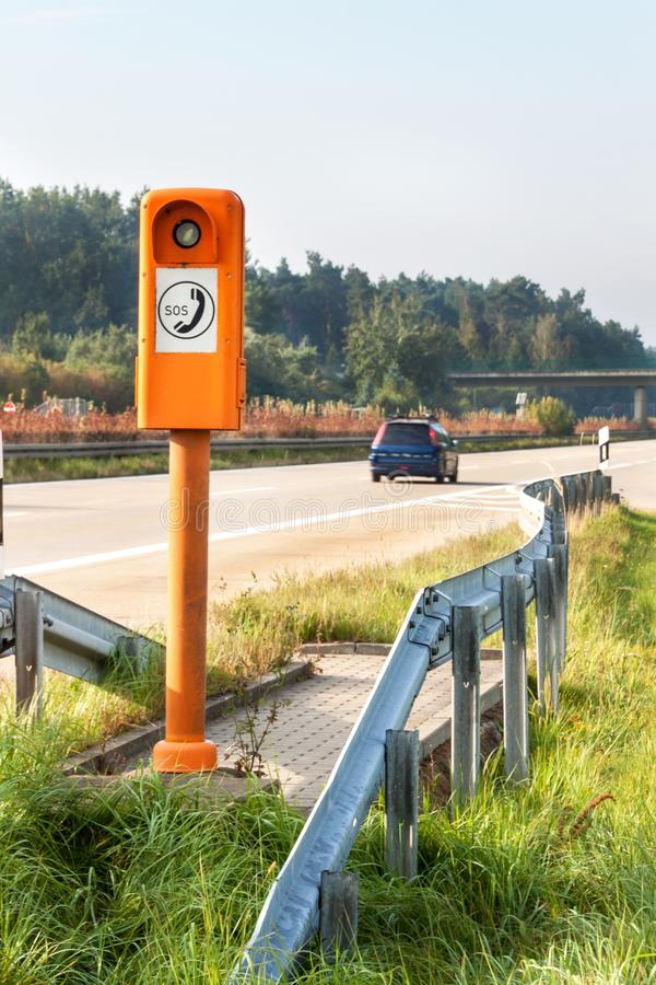 SOS phone. Emergency telephone at the roadside. Morning on the German highway. SOS phone. Emergency telephone at the roadside. Morning on the German highway royalty free stock images