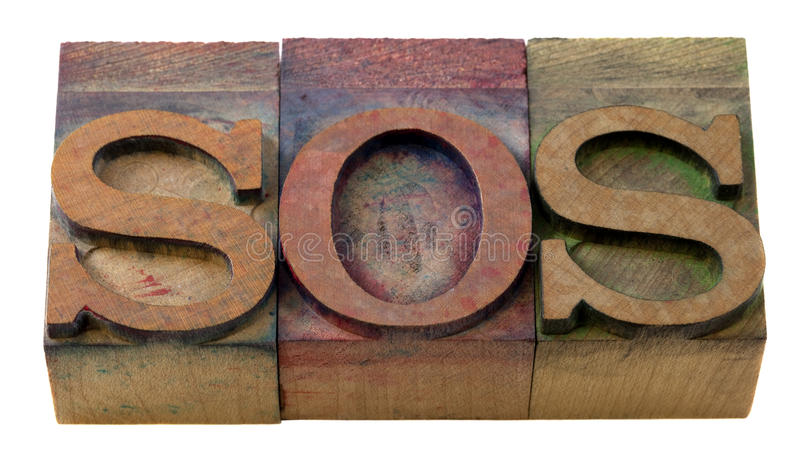 Sos sign in letterpress type stock photo