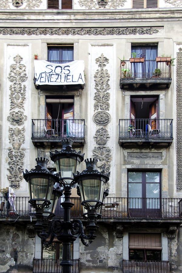 SOS Venezuela. Elegant balcony in Barcelona with the sign SOS Venezuela stock photos