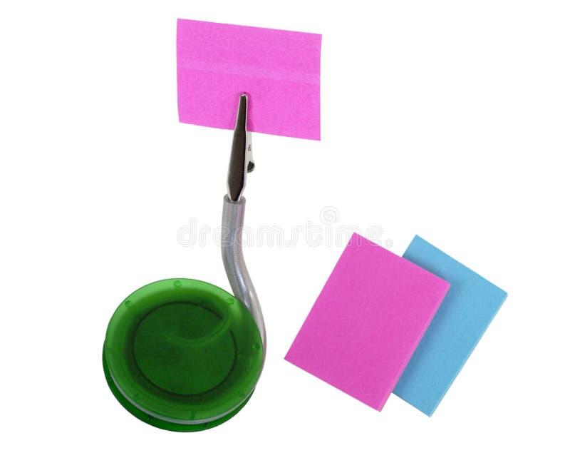 Sostenedor de la nota con las pistas de nota en blanco imágenes de archivo libres de regalías