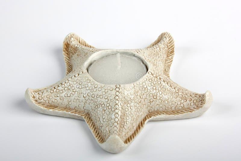 Sostenedor de vela de los pescados de la estrella imagen de archivo