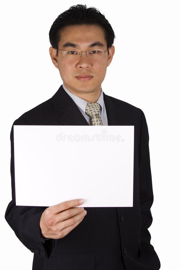 Sostener el papel en blanco imagenes de archivo