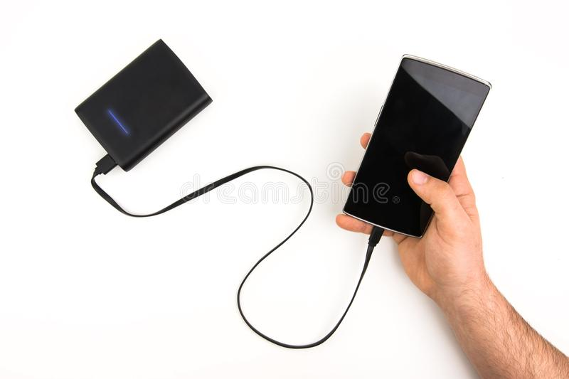 Sostener el teléfono elegante de Chargering a la batería portátil imagen de archivo libre de regalías