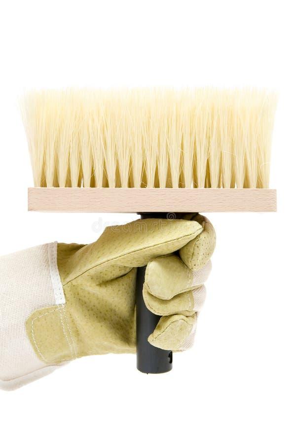 Sostener un cepillo grande foto de archivo libre de regalías