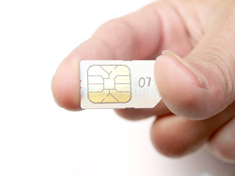 Sostener un SIM fotografía de archivo