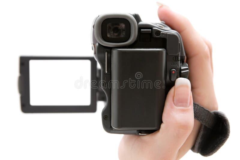 Sostener una videocámara foto de archivo libre de regalías