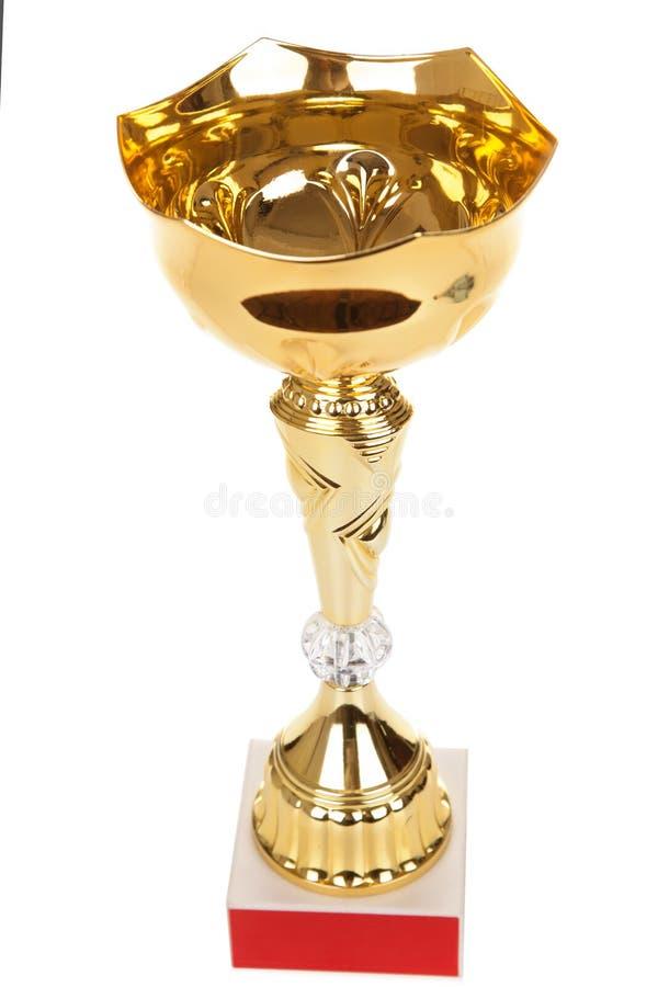 Sostenga il trofeo dorato isolato su fondo bianco, trofeo dell'oro immagini stock