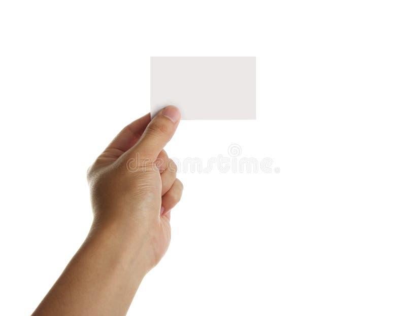 Sostenga la tarjeta de visita en blanco imagen de archivo libre de regalías