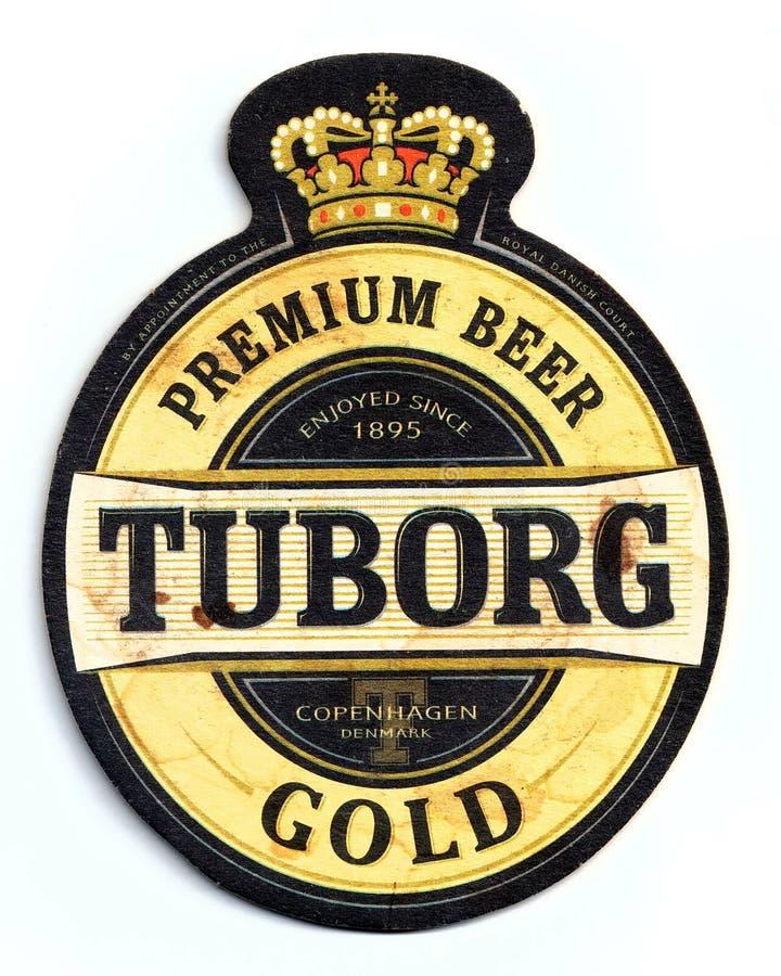 Sottobicchiere della birra dell'oro di Tuborg immagine stock
