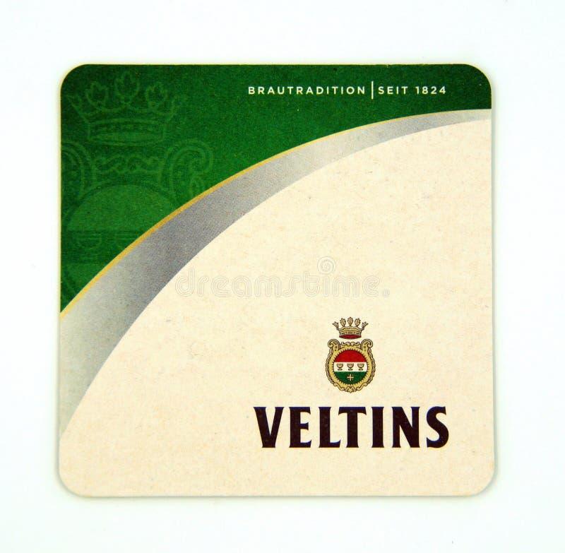 Sottobicchiere della birra di Veltins pilsener fotografia stock