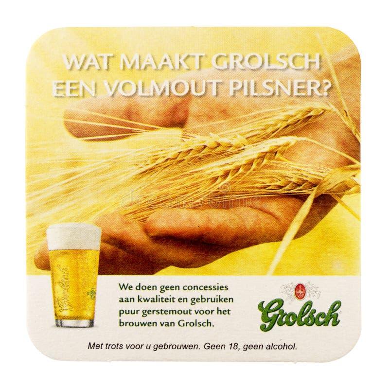 Sottobicchiere della birra per la pubblicità per il volmout di Grolsch fotografia stock libera da diritti