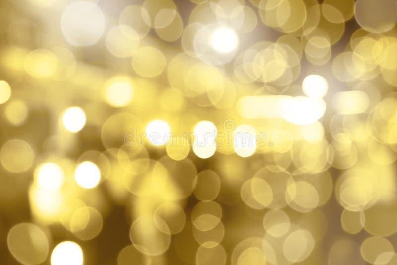 sottragga la priorit? bassa Di sfuocatura colorata d'oro bronzea Sfuocatura del cerchio fotografie stock libere da diritti