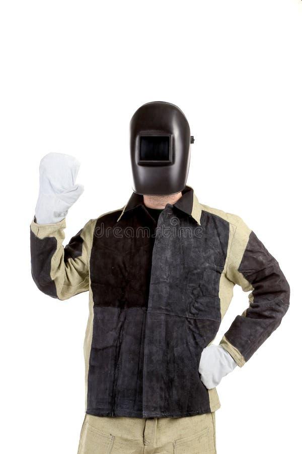 Soudeur sûr dans le masque. photo stock