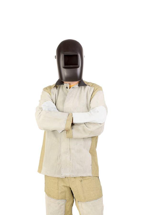Soudeuse dans le masque avec des mitaines. images stock