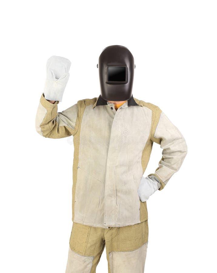 Soudeuse dans le masque avec des mitaines. image libre de droits