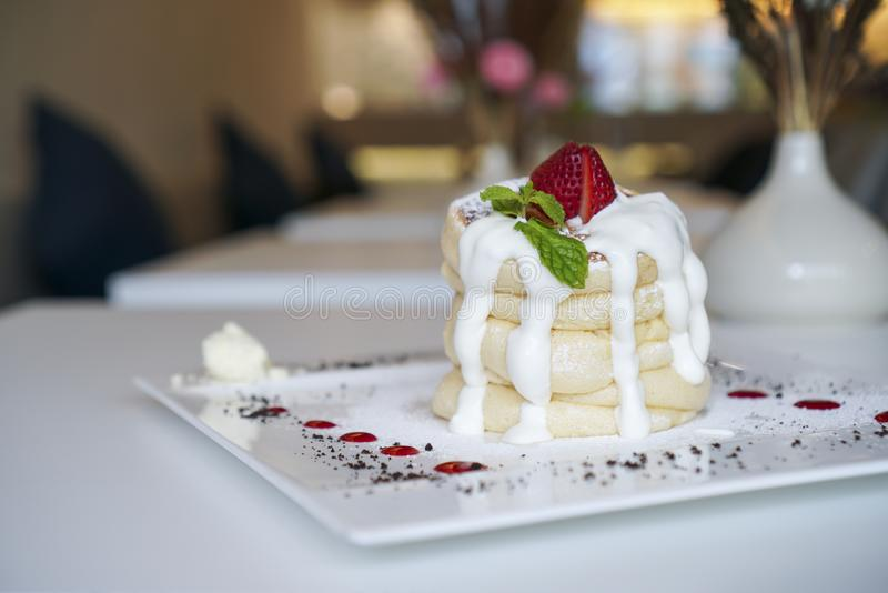 Soufflé pancake topped with strawberry. stock photography
