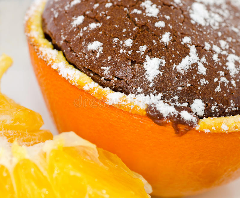 Souffle. A souffle in orange with powder sugar and chocolate royalty free stock photos