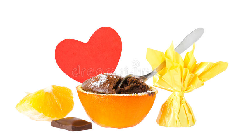 Souffle. A souffle in orange cover with powder sugar and chocolate and love message on red heart royalty free stock photography