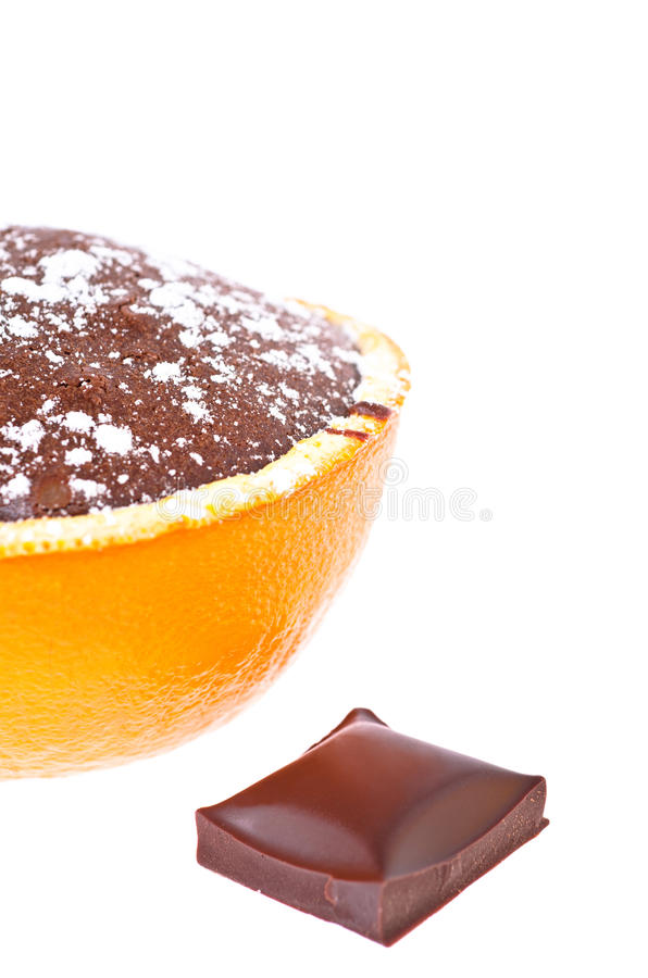 A souffle in orange. With powder sugar and chocolate royalty free stock image