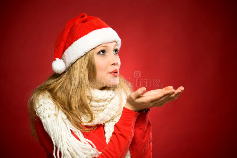 Soufflement de femme de Santa image libre de droits