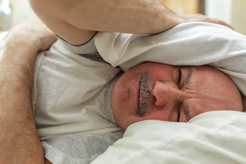 Souffrez de l'insomnie photo stock