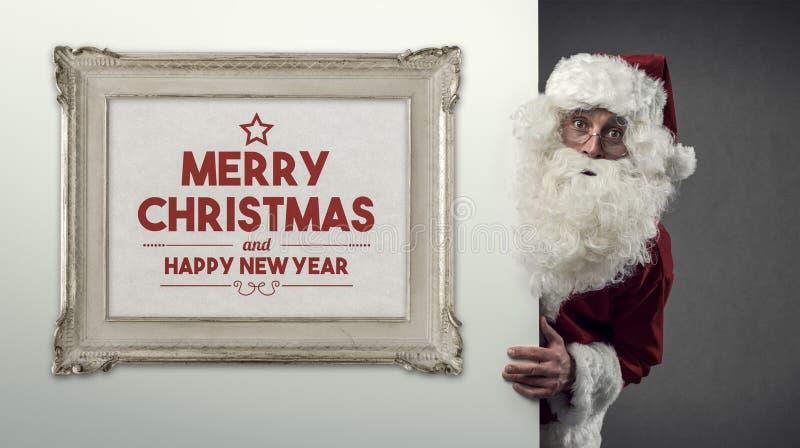 Souhaits de Santa Claus et de Noël image stock