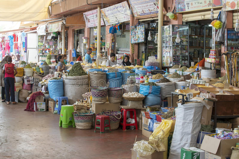 Souk - city market in Agadir. Sellers offer various spices in the city market (Suk) on 28 August 2014 in Agadir, Marocco stock image