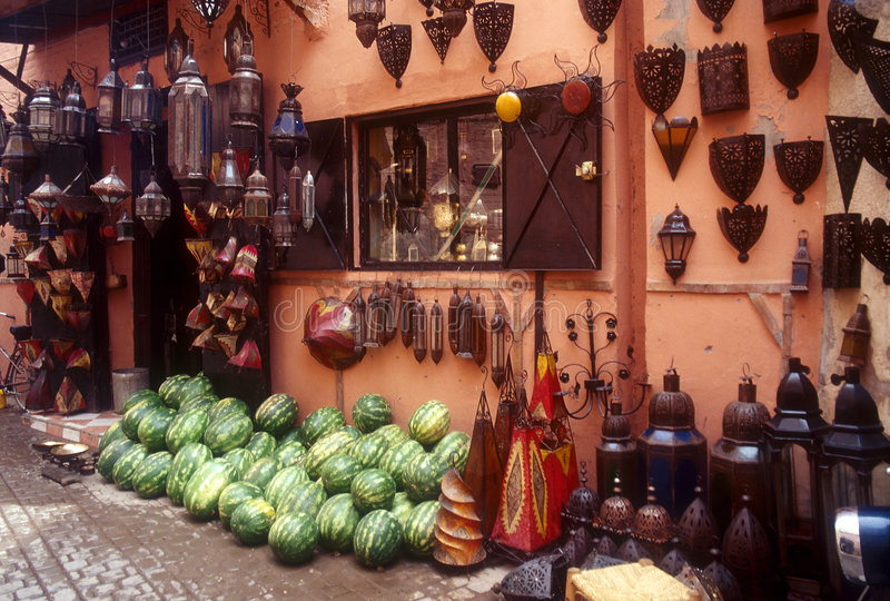 Souk in Marrakesh. Lamps and watermelons in a souk of Marrakesh, Morocco royalty free stock photo