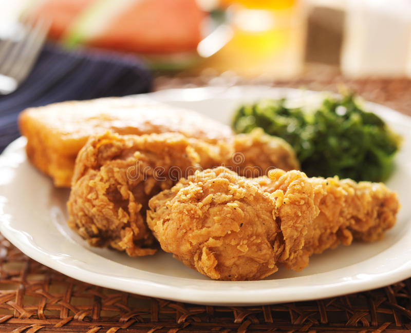 Soul food - fried chicken with collard greens. Fried chicken with collard greens and corn bread royalty free stock photography